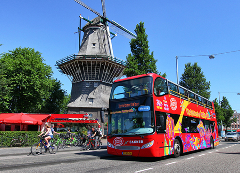 Passing a dutch windmill by sightseeing Amsterdam